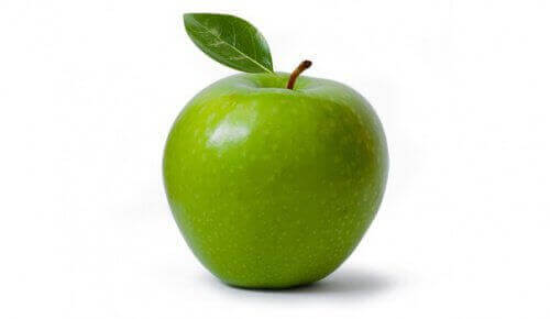 зелене яблуко з листочком
