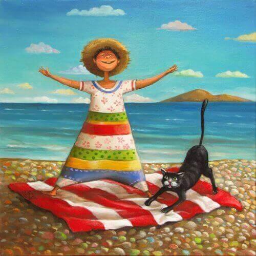 кішка і дитина на пляжі