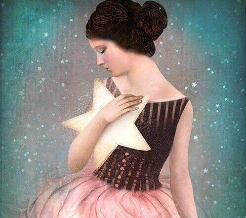 дівчина тримає зірку