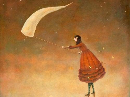 дівчина ловить світлячків