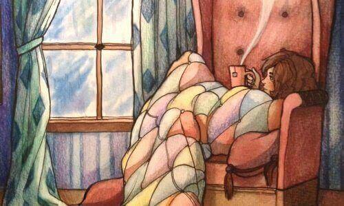 сумна дівчина в кріслі п'є чай