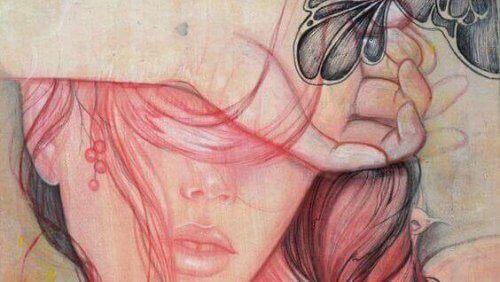 жінка закрила очі рукою