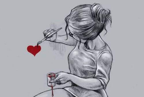 дівчина малює серце