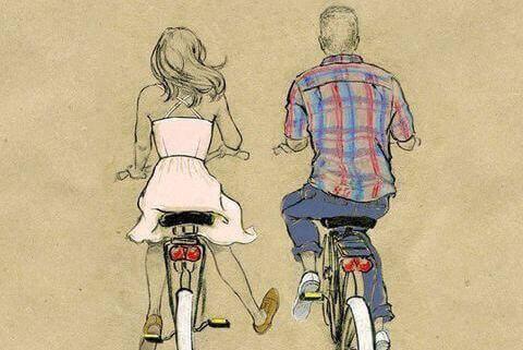 хлопець і дівчина на велосипеді