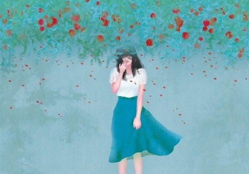 дівчина і червоні квітки