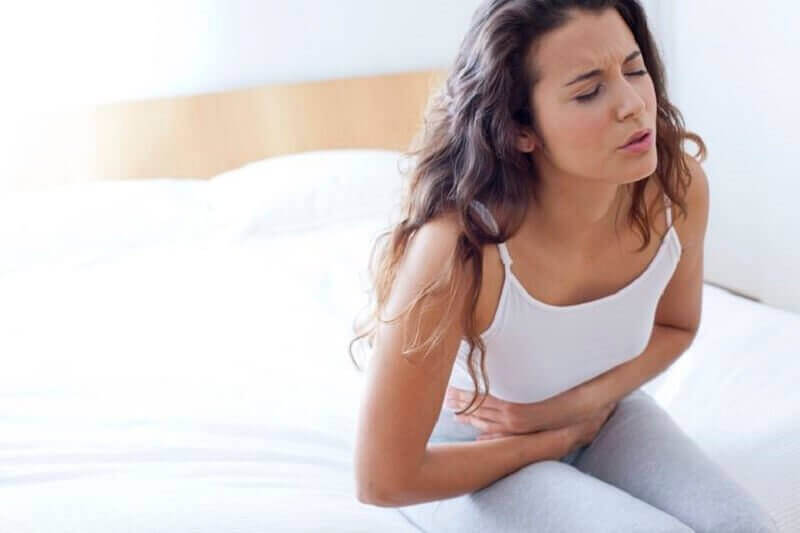 розлади травлення викликають біль у спині