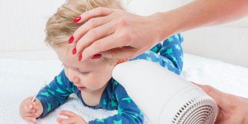очистити вуха від води феном